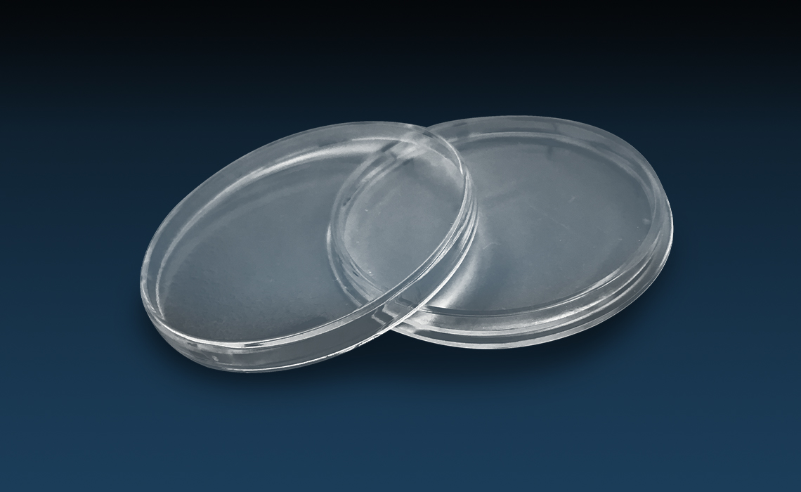 Kapsler i pleksiglass for beskyttelse av mynter og medaljer