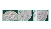 Nærbilde av sølvmynter til OL Tokyo