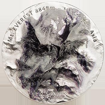 Høyr relieff til ære for kjempehøyt fjell - mynten ærer Mount Everest